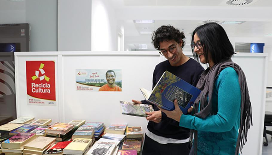 A man and a woman consulting the books on display